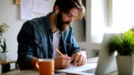 istock Creative man working in his modern home office 641396366