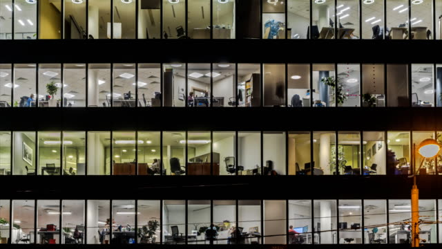 creative office workers during operation and at the end of working day, time lapse