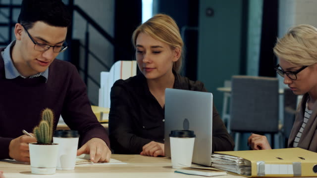 Creative people doing a brainstorming meeting in a modern studio video