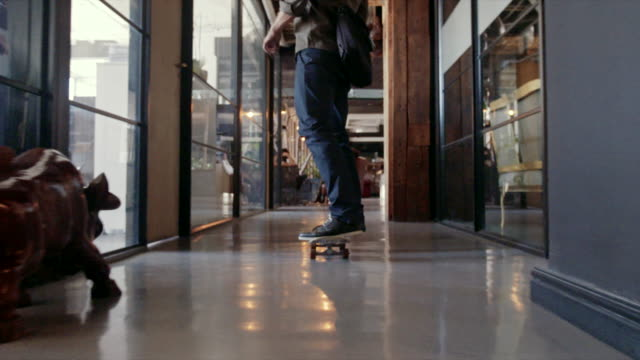 Creative professional skateboarding in office video