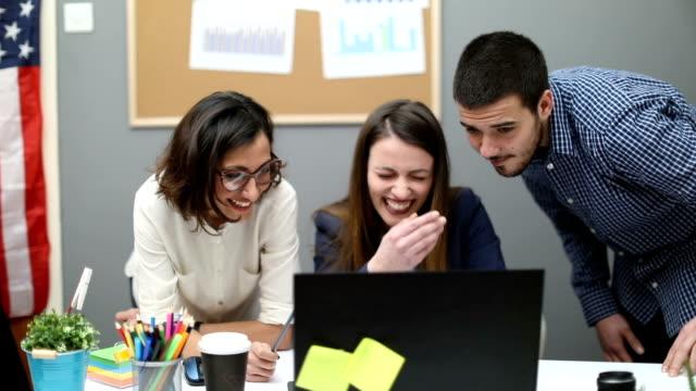 Creative team  at the office having fun video