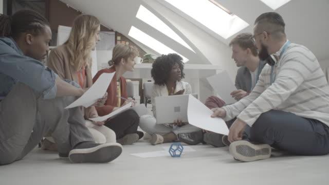 4K: Creative Team Brainstorming On The Floor. video