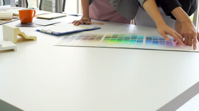 Creative Team See Color Chart On Table Video of creative team see colour chart on table. 4K interior designer stock videos & royalty-free footage