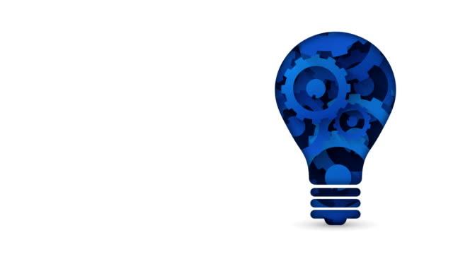 creative technology concept blue gears light bulb