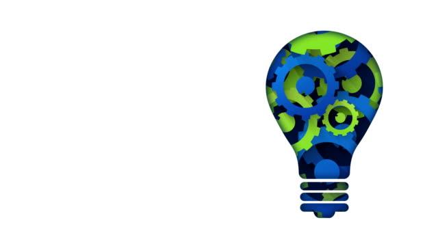 creative technology concept blue green gears light bulb