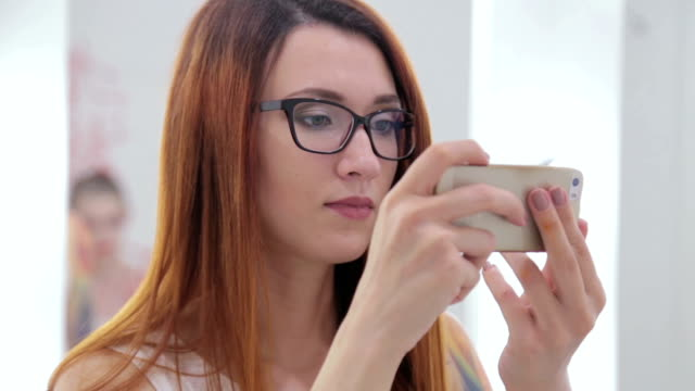Creative woman trying to take photo video