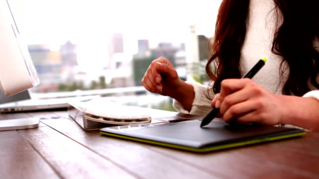 Creative woman using tablet graphic video