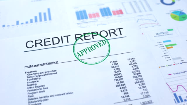 Credit report approved, hand stamping seal on official document, statistics Credit report approved, hand stamping seal on official document, statistics representing stock videos & royalty-free footage