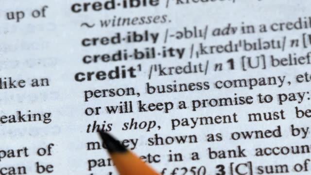 kredit ord mening i engelska ordbok, lån för företag, lovar att betala - stavning bildbanksvideor och videomaterial från bakom kulisserna