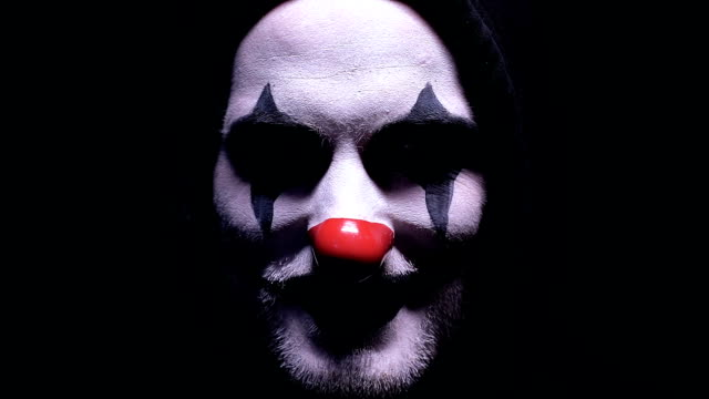 creepy clown smiling into camera isolated on black background, horror, close-up - mardi gras stock videos and b-roll footage