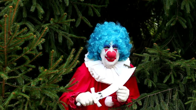 Creepy Clown With Knife Hiding In Trees video