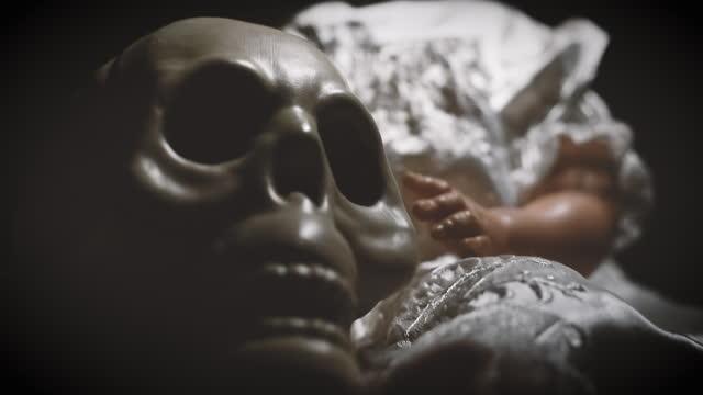 Creepy Doll Holding a Skull