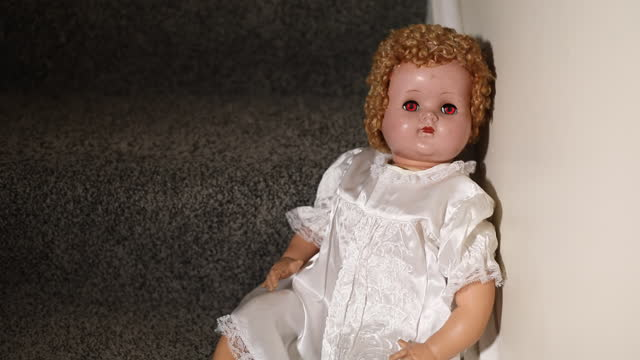Creepy Doll on Stairs Eyes Turn Red Video
