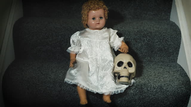 Creepy Doll With Skull on Stairs