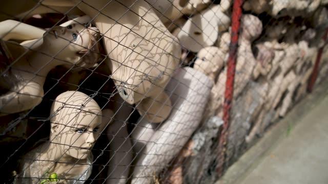 Creepy dolls Creepy dolls behind wires doll stock videos & royalty-free footage