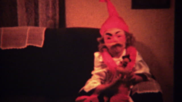 1940: Creepy Halloween costume on cute girl takes off mask. video
