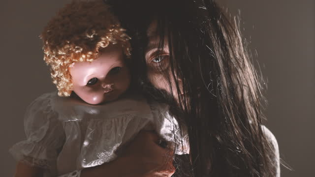 Creepy Woman Holding Spooky Vintage Baby Doll