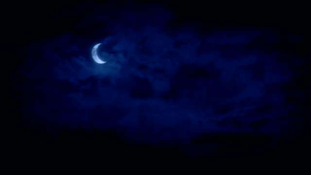 crescent moon in night sky - halloween video stock e b–roll