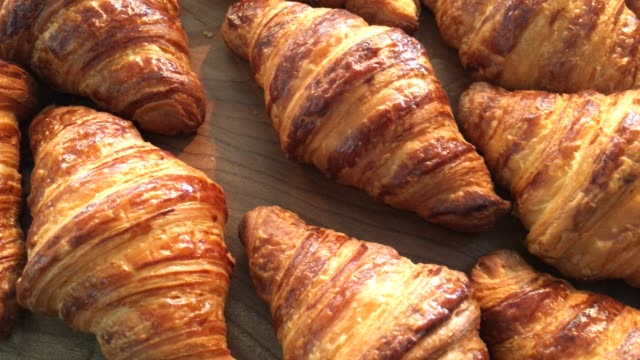 Croissant A croissant is a buttery, flaky, viennoiserie pastry named for its crescent shape. bread stock videos & royalty-free footage