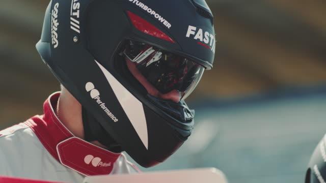 Crew wearing crash helmets during sports race