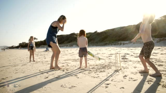 Cricket at the beach Family enjoying the beach australia stock videos & royalty-free footage