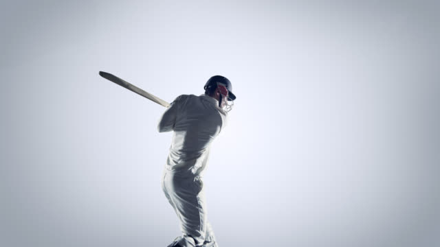 Cricket player in action on white background video