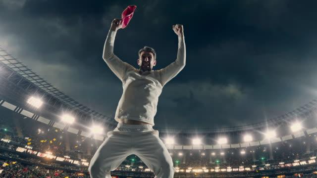 vídeos y material grabado en eventos de stock de jugador de cricket está celebrando en el estadio - críquet