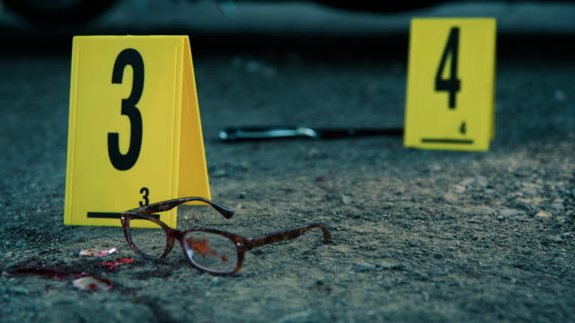 Crime scene investigation Video shoot of crime scene with different evidences on ground crime scene stock videos & royalty-free footage