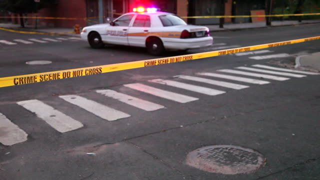 Crime Scene Police crime scene tape on a city street crime scene stock videos & royalty-free footage