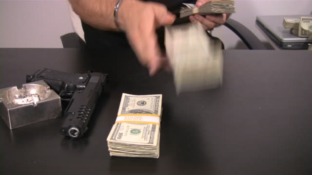 Criminal activity, illegal transaction, crime, mafia.  US Currency. Cash. Money. video