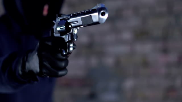 Criminal aiming gun at victim and demanding money and jewels, street robbery Criminal aiming gun at victim and demanding money and jewels, street robbery crime stock videos & royalty-free footage