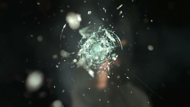 Criminal shoots window, slow motion video