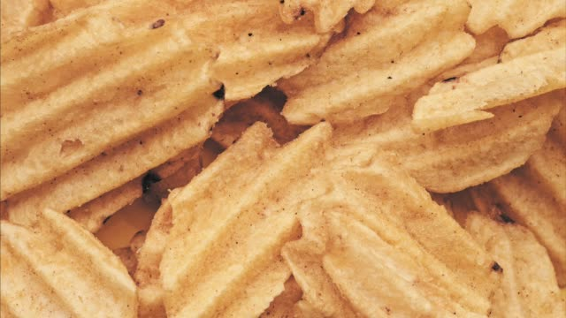 crispy chips funky texture. snack food - dynamic background video
