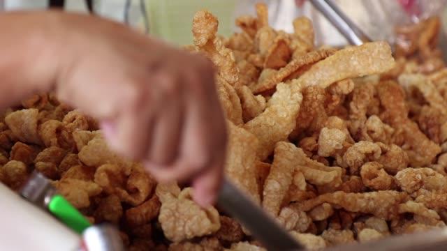 Crispy Pork Skin, Pork rinds also known as chicharon or chicharrones , deep fried pork skin , kab moo Crispy Pork Skin, Pork rinds also known as chicharon or chicharrones , deep fried pork skin , kab moo pork stock videos & royalty-free footage