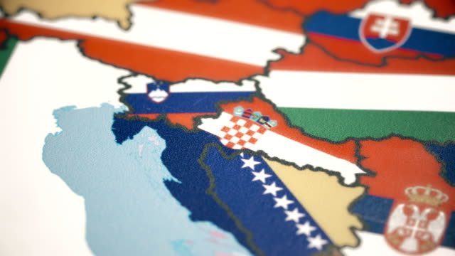 croatia with national flag on world map - serbia video stock e b–roll