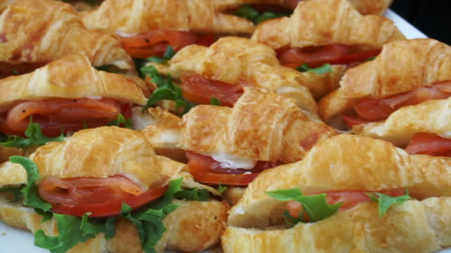 croissant sandwiches in morning buffet line video