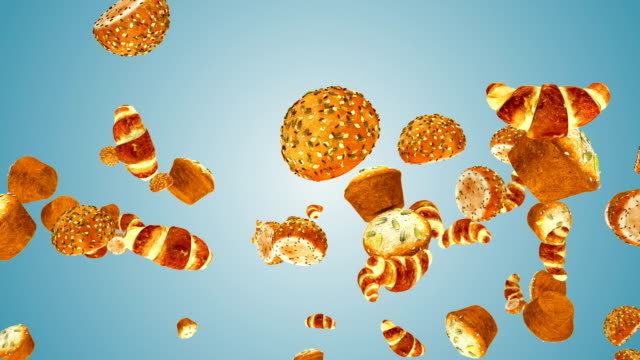 Croissants, muffins and bread buns flying in slow motion against blue gradient Croissants, muffins and bread buns flying in slow motion against blue gradient bun bread stock videos & royalty-free footage