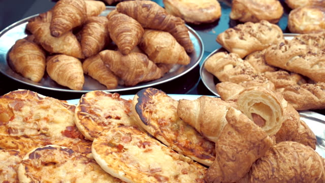 Croissants, pizza, rolls and other bakery products on store shelves video
