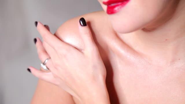 crop alluring model posing sensually - rossetto rosso video stock e b–roll