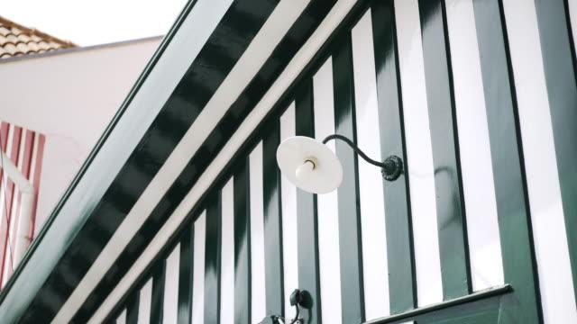 vídeos de stock e filmes b-roll de crop view lantern on colored facade - aveiro