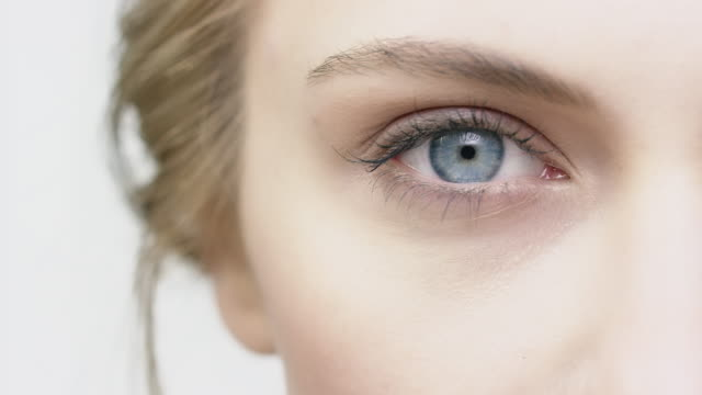 Cropped image of woman opening her blue eye Cropped image of beautiful woman opening her blue eye. Close-up shaky shot of young female having natural beauty. She is staring. eyesight stock videos & royalty-free footage