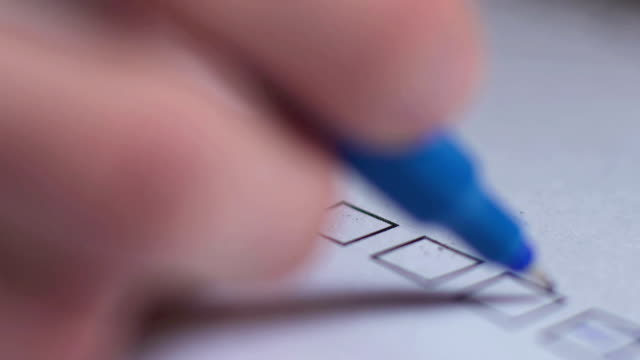 Cropped of businessman writing on checklist Cropped image of businesswoman writing on checklist form filling stock videos & royalty-free footage