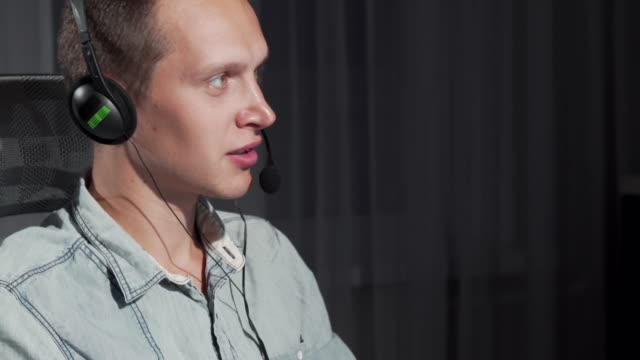 cropped shot of a handsome young man working at call center on night shift - shifts call centre video stock e b–roll