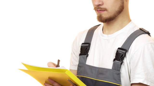 cropped shot of a industry worker smiling making notes on clipboard - craftsman architecture stock videos & royalty-free footage