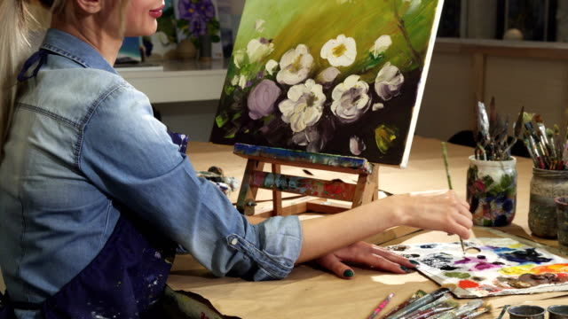 Cropped shot of a smiling female artist drawing flowers at her Art Studio video