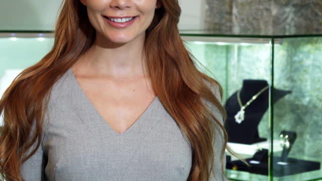 Cropped shot of a woman smiling holding shopping bag video