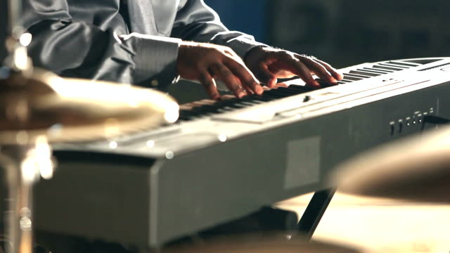 cropped view of black man playing electronic keyboard - musician stock videos and b-roll footage