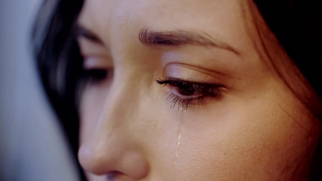 cropped view of crying and attractive woman cropped view of crying and attractive woman brown hair stock videos & royalty-free footage