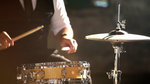 Cropped view of Hispanic man playing drums