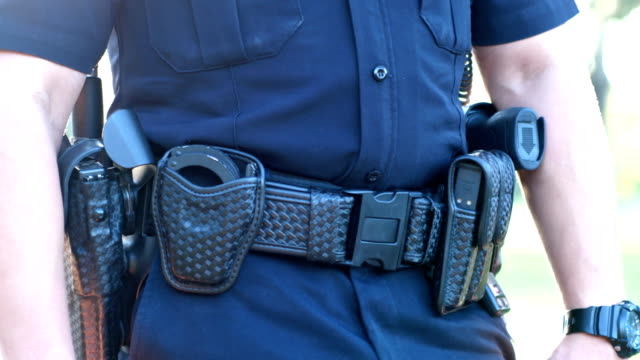 Cropped view of police officer duty belt video